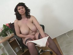 Helenka strips and fingers her pussy in stockings at home