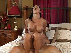 Tanned milf gets a lot of jizz on their way face and tits